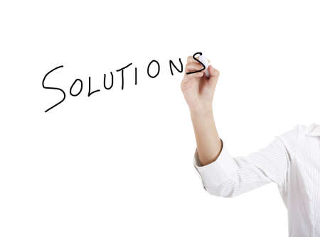 Young businesswoman woman drawing the word solution photo