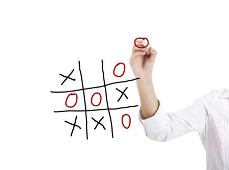 Crosses: Young businesswoman playing the game noughts and crosses