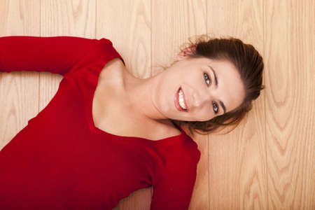 Beautiful woman lying on the floor and smiling to the camera Stock Photo - 15760643
