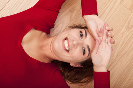 Beautiful woman lying on the floor and smiling to the camera Stock Photo - 15760654