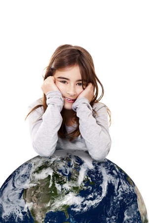 Portrait of a little girl with a small planet earth beneath her, isolated on white background photo