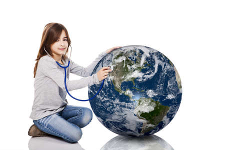 Portrait of a little girl auscultate the health of the planet earth with a stethoscope, isolated on white background photo