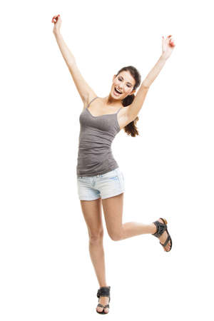 Portrait of a beautiful and happy young woman with arms raised, isolated on white Stock Photo - 16126398