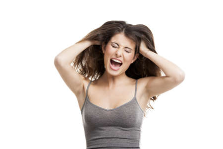 Portrait of a young woman yelling really loud, isolated on white Stock Photo