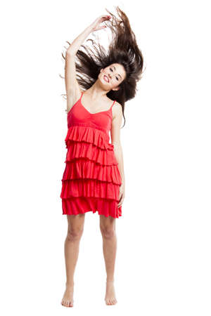 Beautiful woman with a red dress dancing and jumping, isolated on white Stock Photo - 16126404