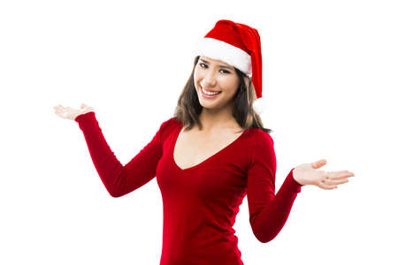 Beautiful asian woman wearing Santas hat with arms open, isolated on white photo