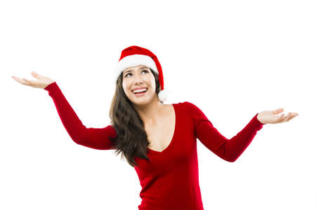 Beautiful asian woman wearing Santas hat looking up with arms open, isolated on white photo