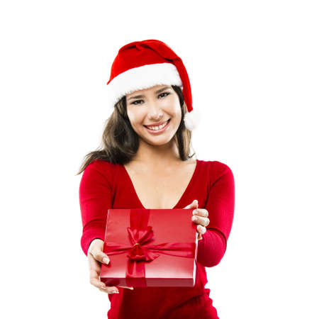 Beautiful asian woman wearing Santa's hat and holding a christmas gift, isolated on white Stock Photo - 16126405