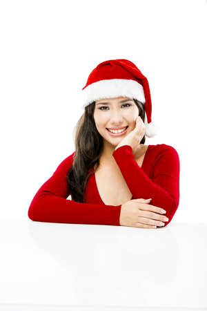 Beautiful asian woman with a beautiful smile wearing Santa's hat,  isolated on white Stock Photo - 16126414