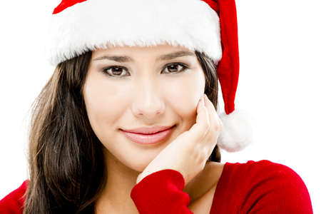 Beautiful close-up portrait of a asian woman with a beautiful smile wearing Santas hat photo