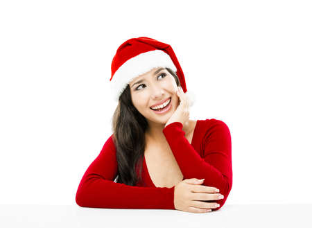 Beautiful asian woman with a beautiful smile wearing Santas hat,  isolated on white photo