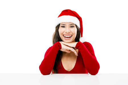 Beautiful asian woman with a beautiful smile wearing Santa's hat,  isolated on white Stock Photo - 16126407