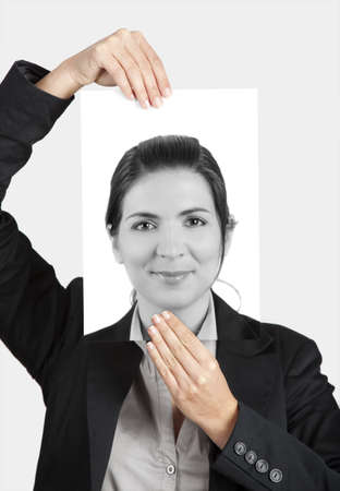 Woman holding a self portrait in front of her face photo