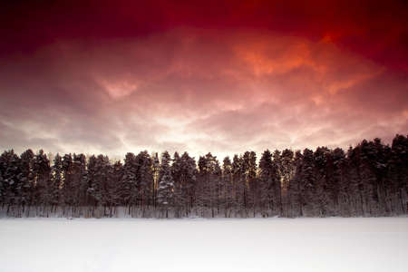 Landscape picture of a frozen lake on a beautiful day with a red sunset Stock Photo - 16784527