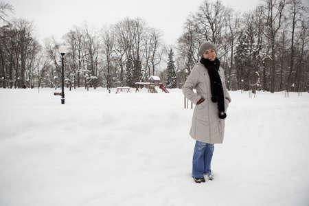 Beautiful woman enjoying a winter day full of snow photo