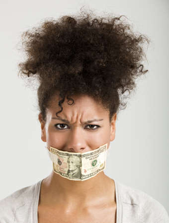gagged: African American woman covering her mouth with a dollar banknote, great concept for the global crises