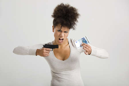 African woman shooting a euro banknote, great concept for the global crises photo