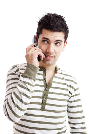 Handsome young man making a phone call, isolated on white background Stock Photo - 17041454