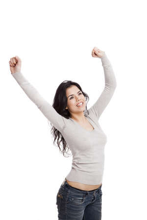 Happy young woman with arms up, isolated against a white background Stock Photo - 17041251