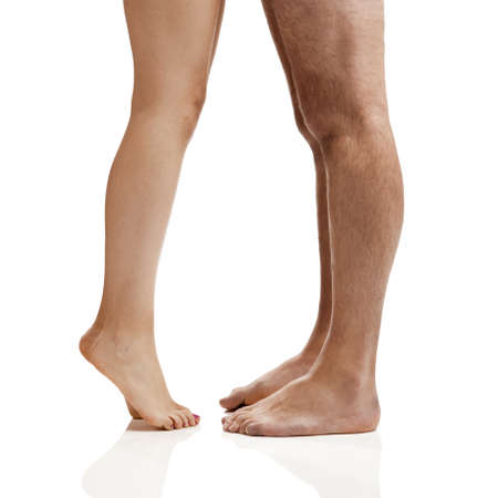 woman nude standing: Man and woman legs isolated on a white background