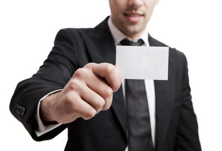 Young businessman holding a personal card on the hand, isolated over a white background
