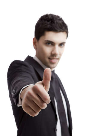 Young businessman with thumbs up isolated over a white background, shallow focus Stock Photo - 17041249
