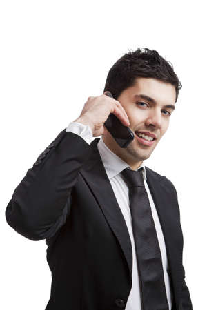 Businessman talking at cellphone, isolated over a white background Stock Photo - 17041267
