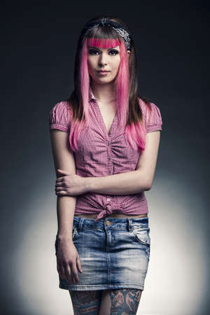 Portrait of a young punk girl with a nice hair cut in pink Stock Photo - 17041414