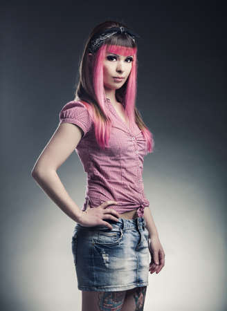 Portrait of a young punk girl with a nice hair cut in pink Stock Photo - 17041408