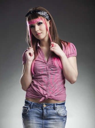 Portrait of a young punk girl with a nice hair cut in pink Stock Photo - 17041415