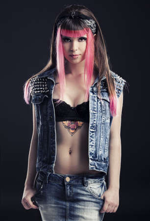 Portrait of a young punk girl with a nice hair cut in pink Stock Photo - 17041460