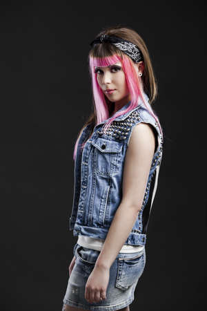 Portrait of a young punk girl with a nice hair cut in pink Stock Photo - 17041405
