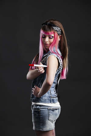 Portrait of a young punk girl with a nice hair cut in pink Stock Photo - 17041458