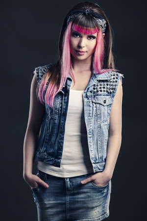 Portrait of a young punk girl with a nice hair cut in pink Stock Photo - 17041418