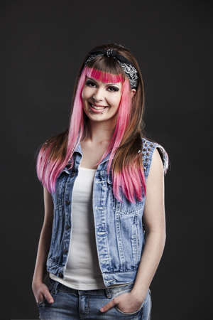 Portrait of a young punk girl with a nice hair cut in pink Stock Photo - 17041406