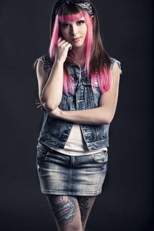 Portrait of a young punk girl with a nice hair cut in pink Stock Photo - 17041404