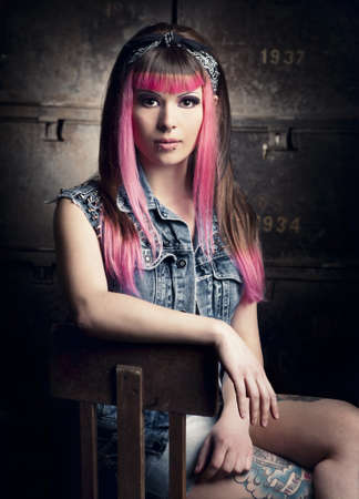 Portrait of a young punk girl with a nice hair cut in pink Stock Photo - 17041268