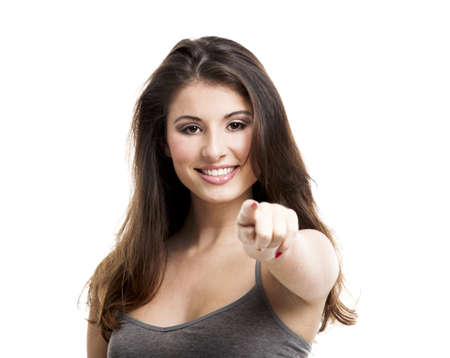 Portrait of a beautiful young woman pointing to somewhere, isolated on white Stock Photo - 17041257