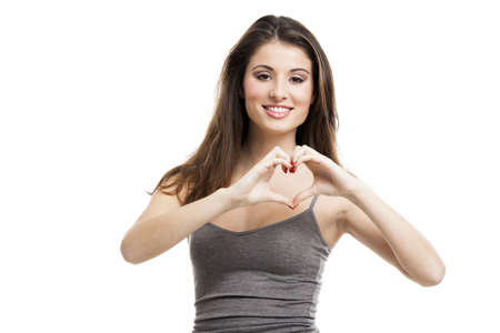 Beautiful and happy young woman doing a heart with her hands, isolated on white Stock Photo - 17041258
