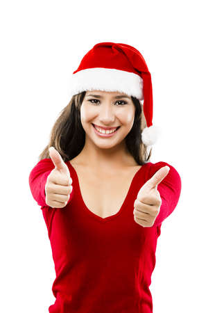 Beautiful asian woman wearing Santa's hat with thumbs up, isolated on white Stock Photo - 17041252