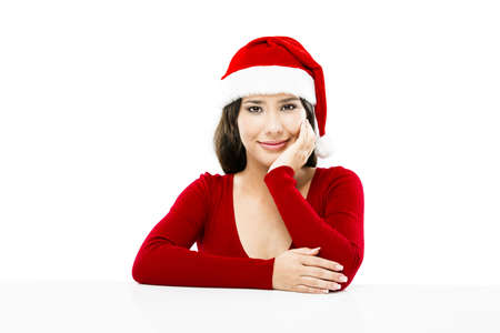 Beautiful asian woman with a beautiful smile wearing Santa's hat,  isolated on white Stock Photo - 17041254