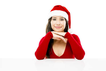 Beautiful asian woman with a beautiful smile wearing Santa's hat,  isolated on white Stock Photo - 17041250