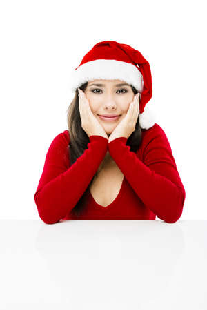 Beautiful asian woman with a beautiful smile wearing Santa's hat,  isolated on white Stock Photo - 17041264