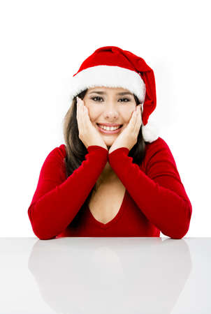 Beautiful asian woman with a beautiful smile wearing Santa's hat,  isolated on white Stock Photo - 17041423