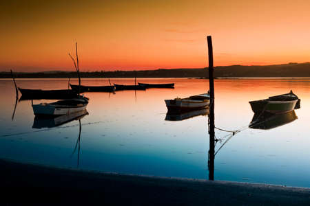 Beautiful landscape of a river and boats at sunset Stock Photo - 17227260