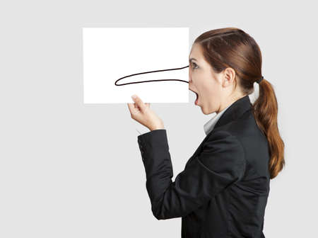 Woman holding a  paper sheet with a sketch of pinnochio nose on it Stock Photo - 17221833