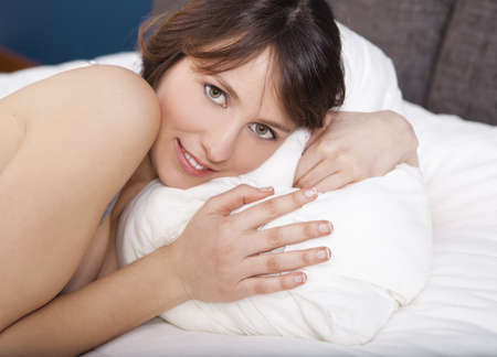Beautiful young woman lying on the bed Stock Photo - 17241095