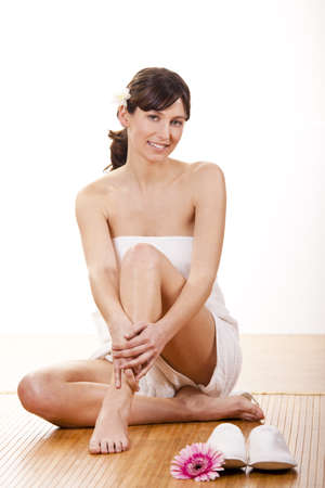 woman towel: Portrait of beautiful young woman before a spa treatment
