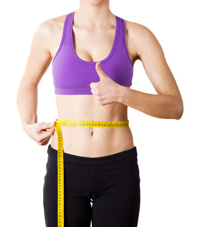 Athletic young women taking measurements of her own body - Healthy body concept Stock Photo - 17221829