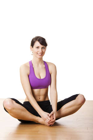 Beautiful and athletic young woman doing yoga exercises Stock Photo - 17221819